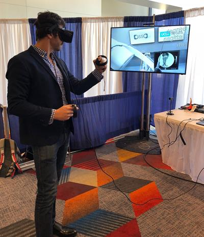 Dr. Justin Barad demonstrates the Osso VR virtual surgery simulator